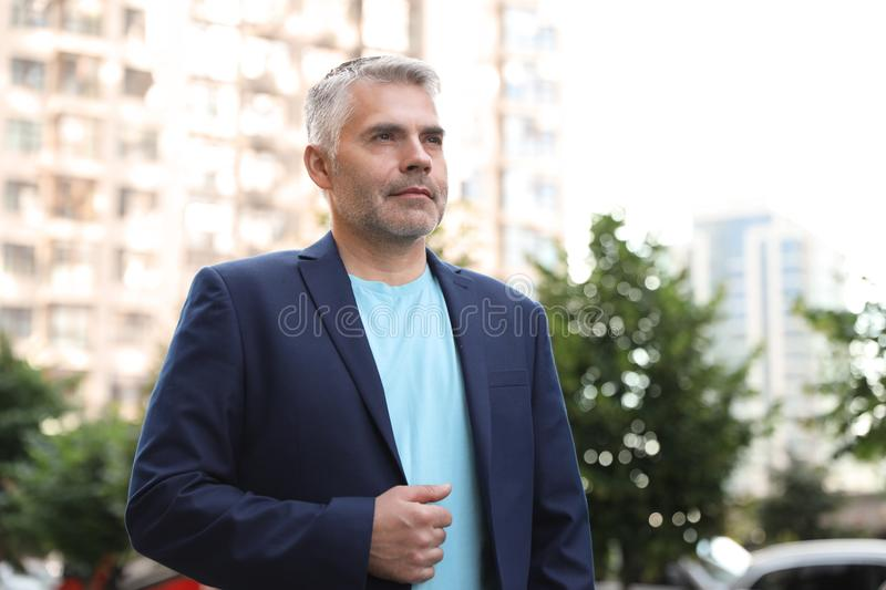 Portrait of handsome mature man in city center stock photo