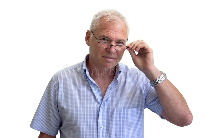 Portrait of a handsome mature man with glasses. A mature man with glasses looks over the glasses and holds them with his hand. Shot close-up on white background stock image