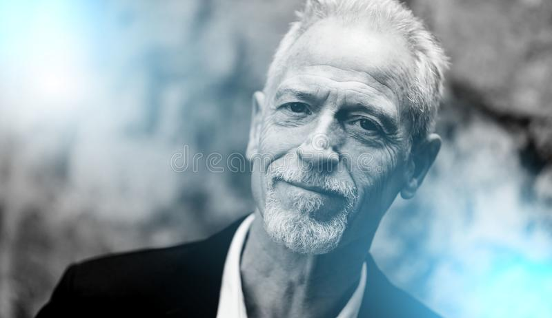 Portrait of handsome mature man, light effect; black and white royalty free stock photos
