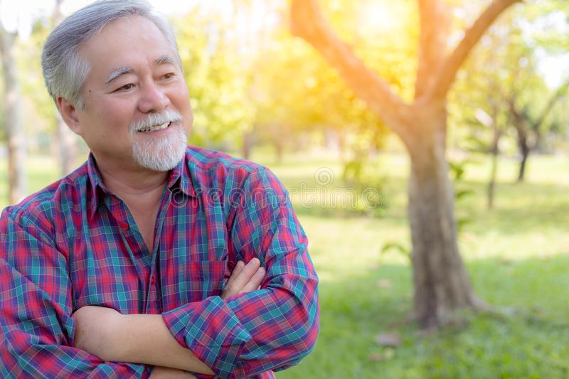 Portrait handsome old man. Attractive handsome grandfather cross arms and proud of his self. Grandpa get successful of his stock image