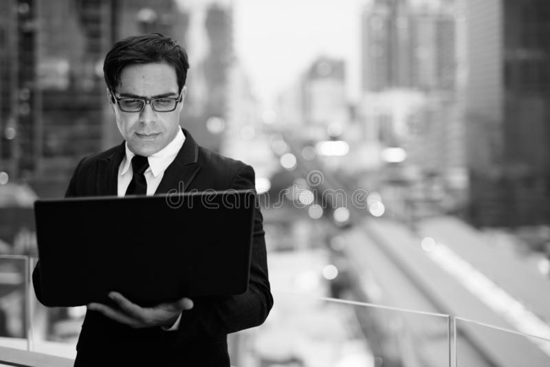 Handsome Persian businessman against view of the city royalty free stock image