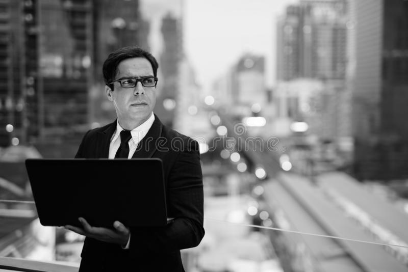 Handsome Persian businessman against view of the city royalty free stock photo