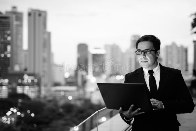 Handsome Persian businessman against view of the city royalty free stock photos
