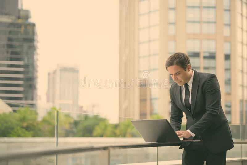 Handsome Persian businessman against view of the city royalty free stock photography