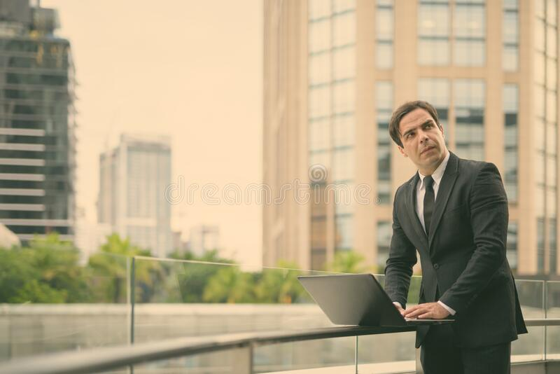 Handsome Persian businessman against view of the city stock images