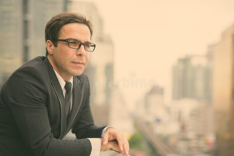 Handsome Persian businessman against view of the city stock photos