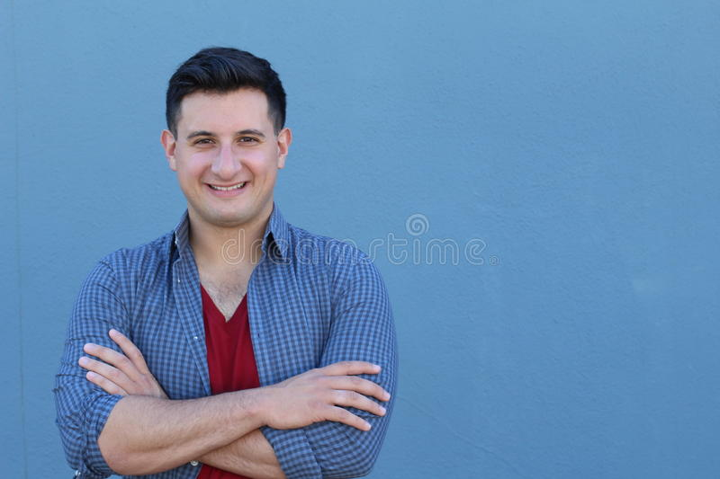 Portrait of handsome real looking man smiling with his arms crossed.  royalty free stock photography