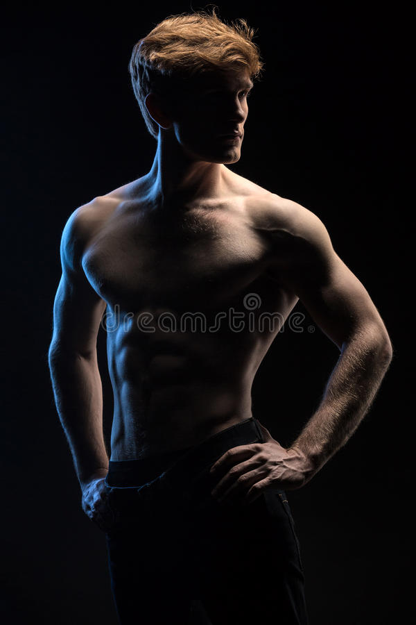 Portrait of handsome red-haired athlete topless at royalty free stock photos