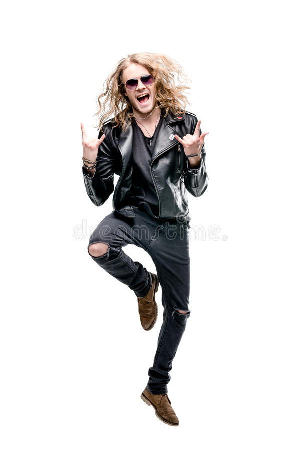 Portrait of handsome rocker in black leather jacket and sunglasses showing rock signs isolated on white stock photo