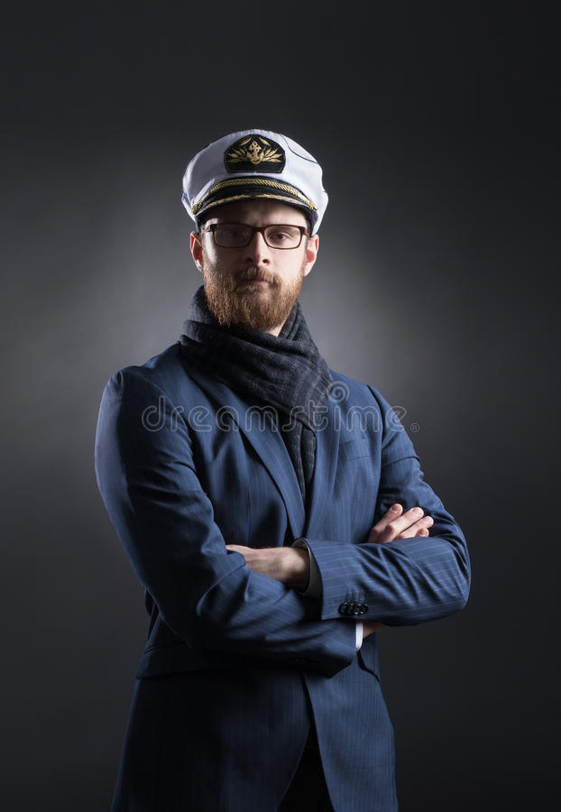 Portrait of a handsome sailor on a dark background. Portrait of a handsome sailor over black background. Shipping, navigation, marine, navy concept royalty free stock photo