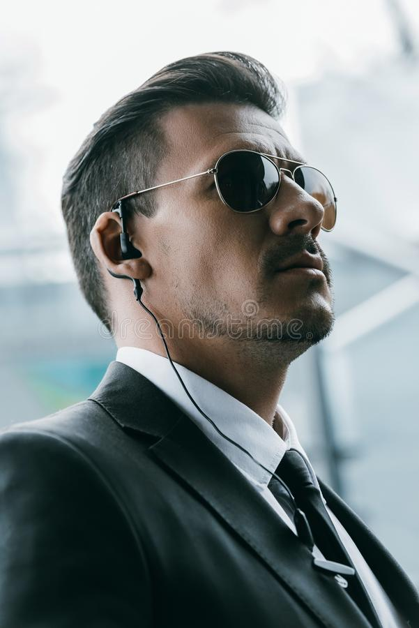 portrait of handsome security guard in sunglasses royalty free stock image