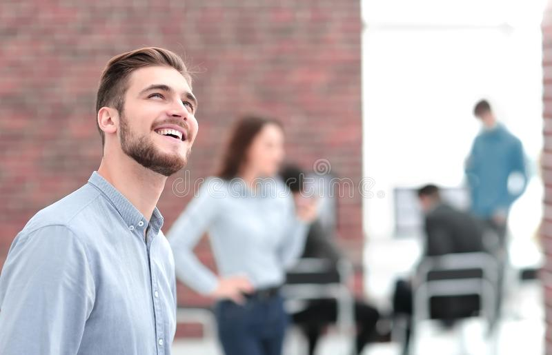 Portrait of young businessman in office. Portrait of a handsome smiling confident businessman stock image
