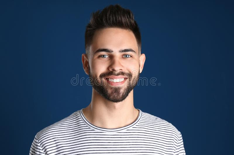 Portrait of  smiling man on color background royalty free stock images