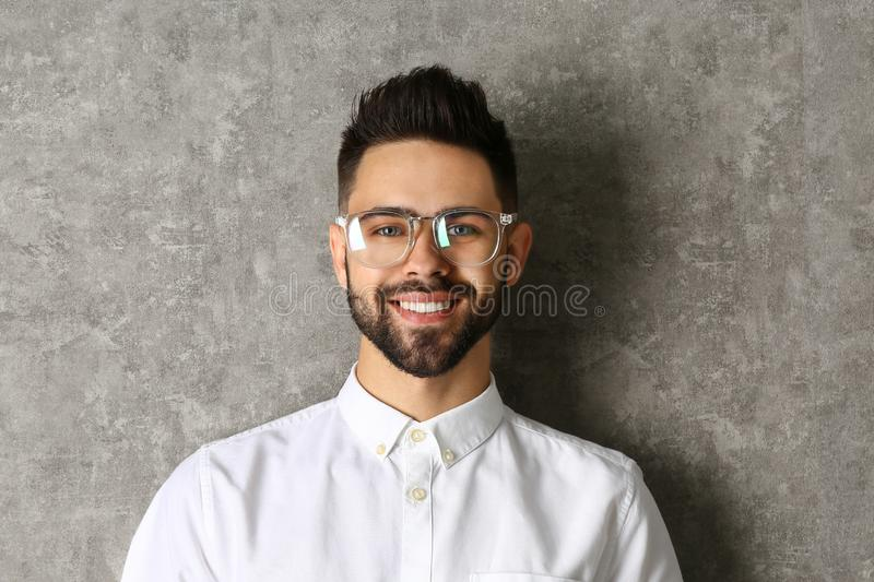 Portrait of handsome smiling man in  on grey background royalty free stock photography