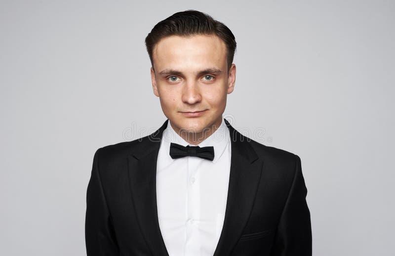 Portrait of handsome stylish man in elegant black suit stock image