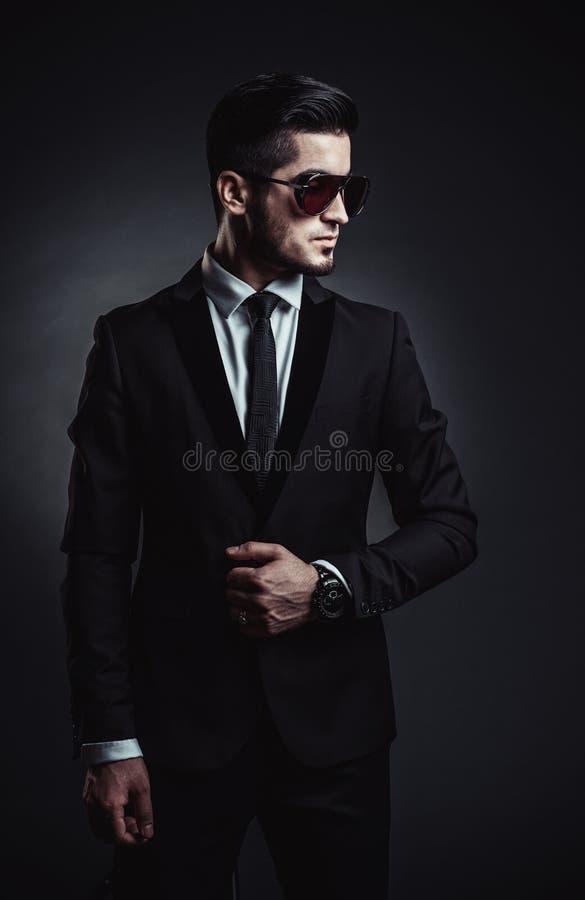 Portrait of handsome stylish man in elegant black suit stock photo