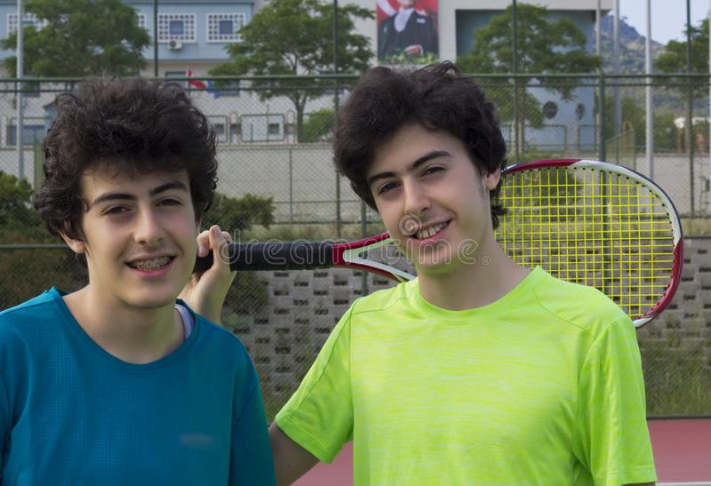 Portrait of happy twins on the court royalty free stock photo