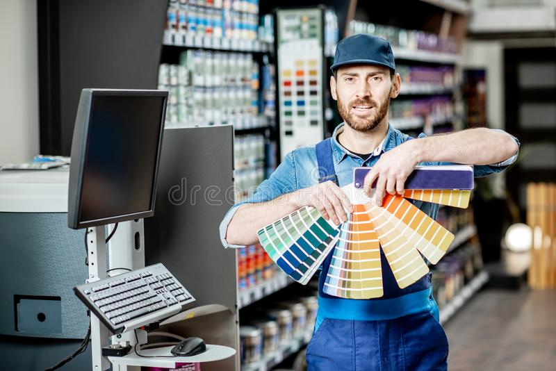 Workman with color swatches in the building shop royalty free stock photo