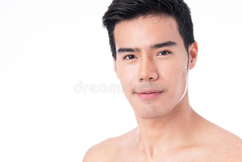 Portrait of Handsome young asian man isolated on white background. Concept of men`s health and beauty, self-care, body and skin. Care. After exercise and stock images