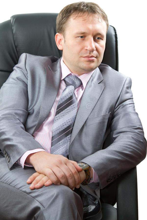 Portrait of a handsome young boss, isolated on white background. royalty free stock images