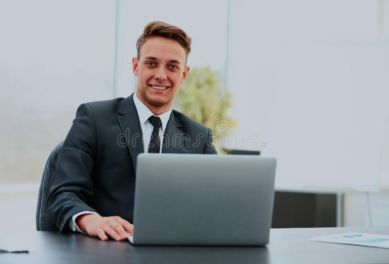 Portrait of a handsome young business man with laptop. stock photo