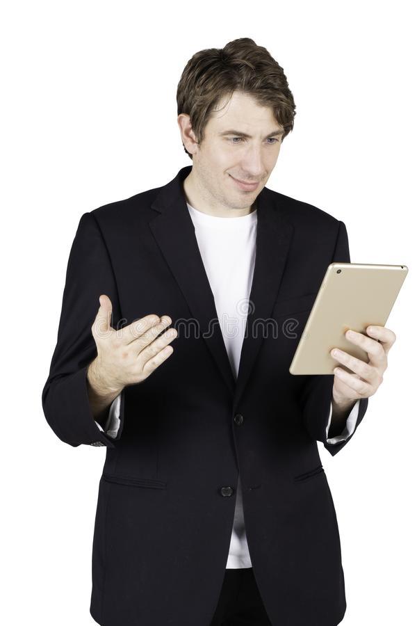 Portrait of handsome young businessman standing holding using tablet and checking email or shopping online. Isolated on white background royalty free stock images