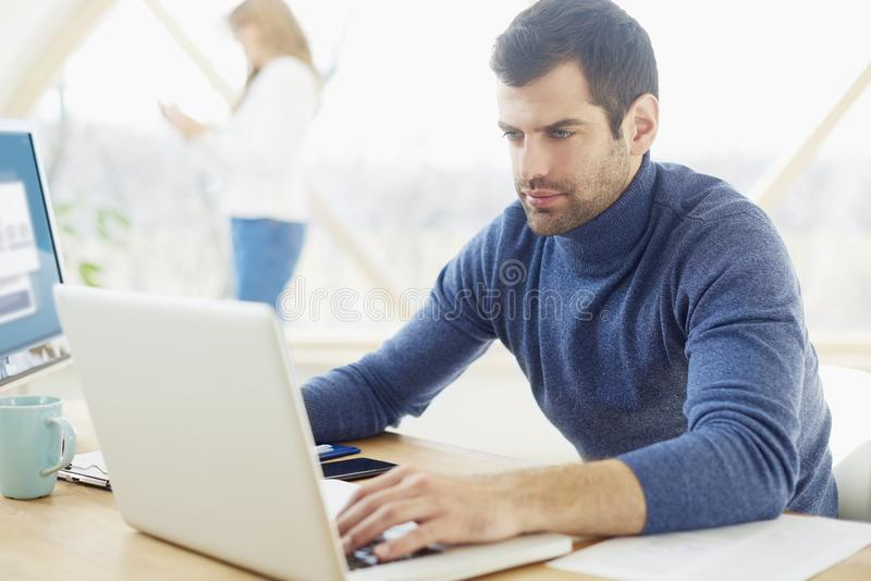 Young businessman working from home royalty free stock photos