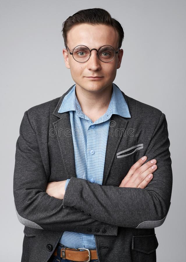 Portrait of a handsome young businessman wearing glasses isolated stock photos