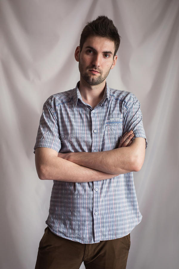 portrait of a handsome young man with a beard in a plaid shirt stock images