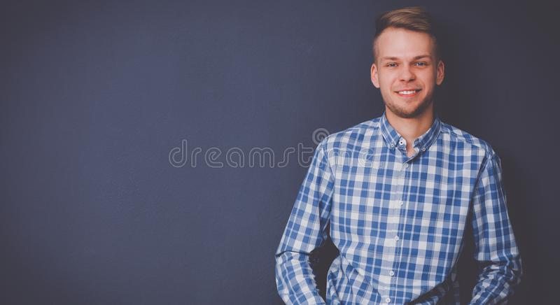 Portrait of a handsome young man on black background stock image