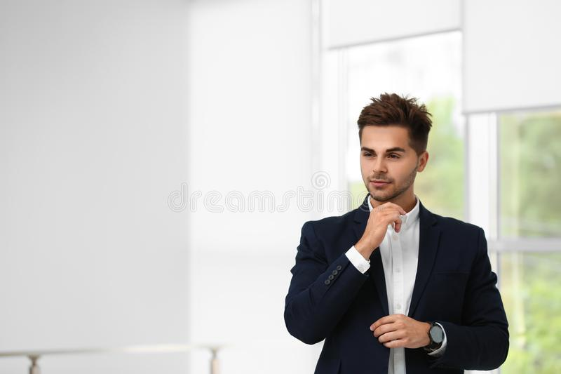 Portrait of handsome young man in elegant suit. Space for text royalty free stock image