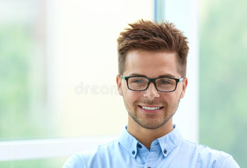 Portrait of handsome young man with glasses stock image