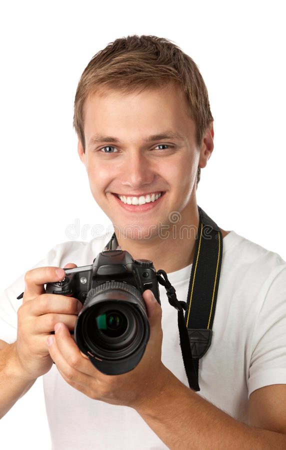 Portrait of a handsome young man holding a camera royalty free stock images