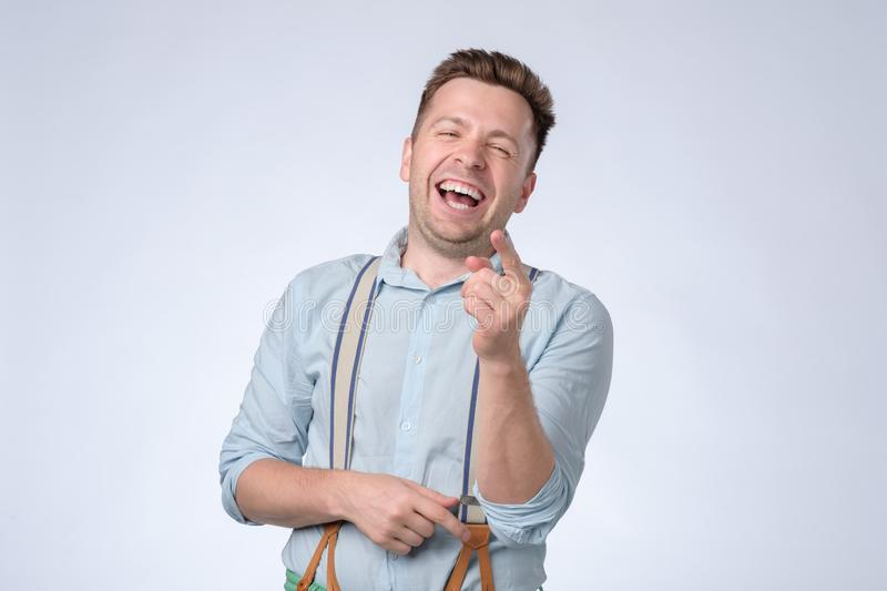 Portrait of a handsome young man laughing stock photo