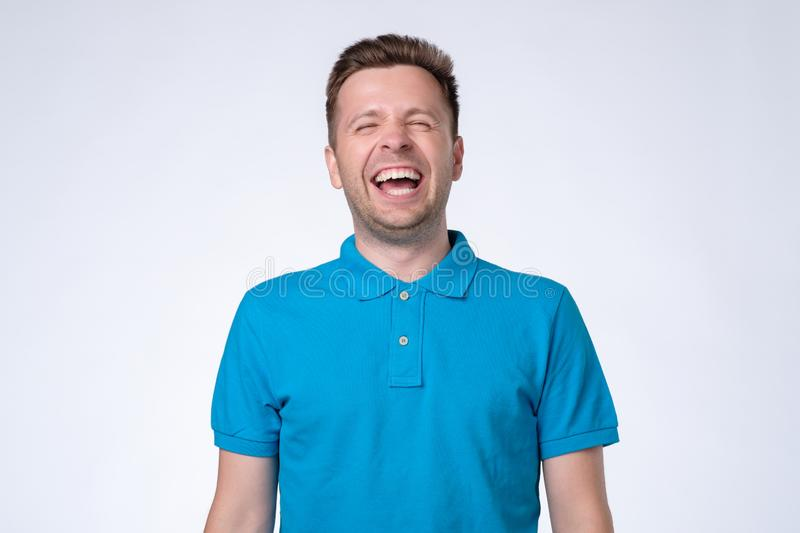 Portrait of a handsome young man laughing royalty free stock photography