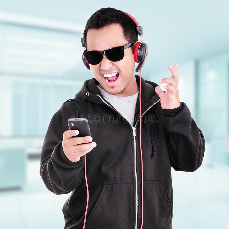 Portrait of a handsome young man listening to music. Indoor royalty free stock images