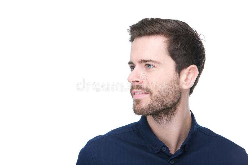 Portrait of a handsome young man looking away stock image