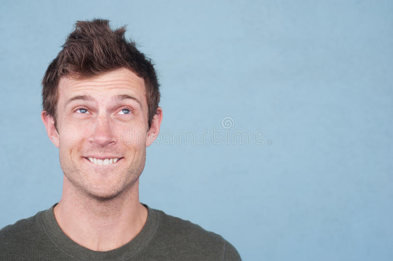 Portrait of a handsome young man looking up stock images