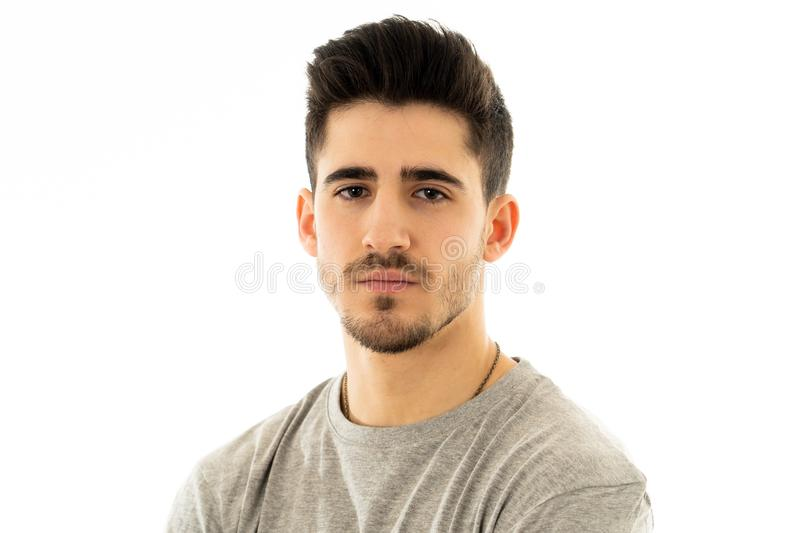 Portrait of handsome young man in neutral poker facial expressions and human emotions. Close up portrait of attractive, confident young man looking neutral stock image