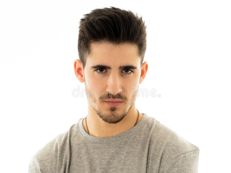 Portrait of handsome young man in neutral poker facial expressions and human emotions stock photo