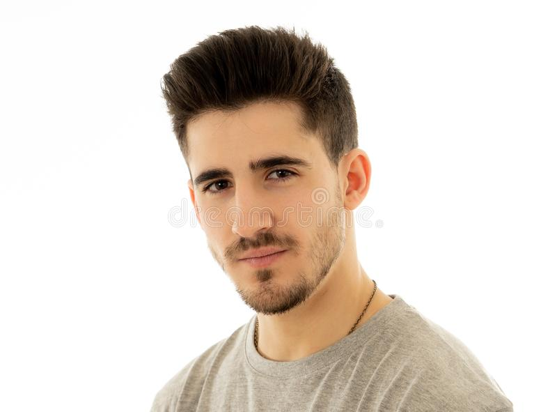 Portrait of handsome young man in neutral poker facial expressions and human emotions. Close up portrait of attractive, confident young man looking neutral stock photography