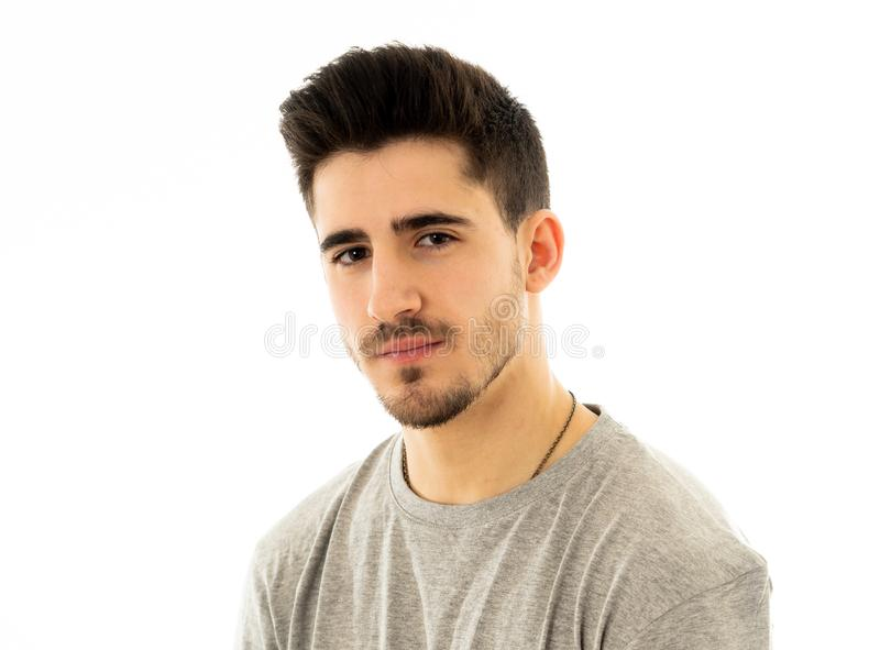 Portrait of handsome young man in neutral poker facial expressions and human emotions royalty free stock image