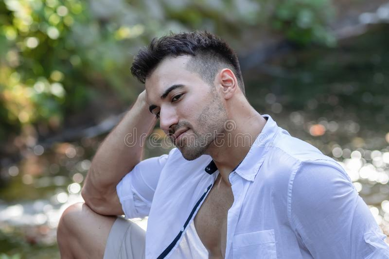 portrait of handsome young man, outdoor stock image