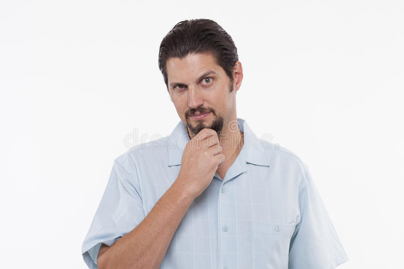 Portrait of a handsome young man posing with hand on chin stock photography