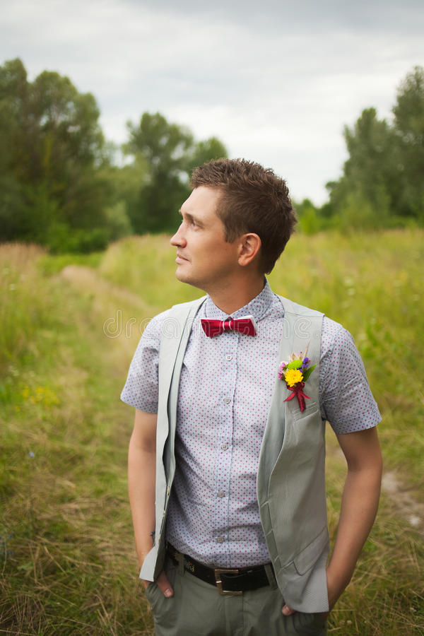Portrait of handsome young man smartly dressed stock photo