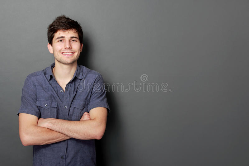 Portrait of a handsome young man smiling royalty free stock photo