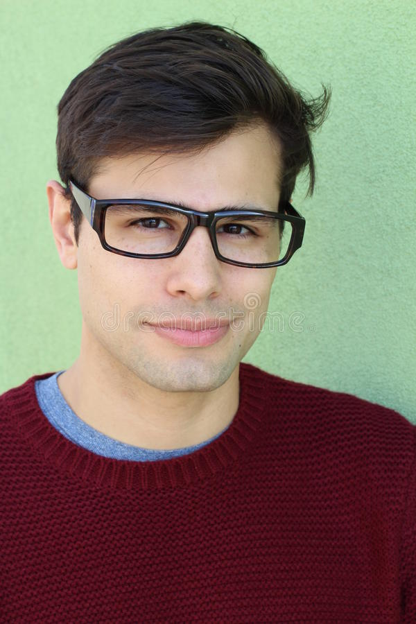 Portrait of a handsome young man in spectacles stock photo