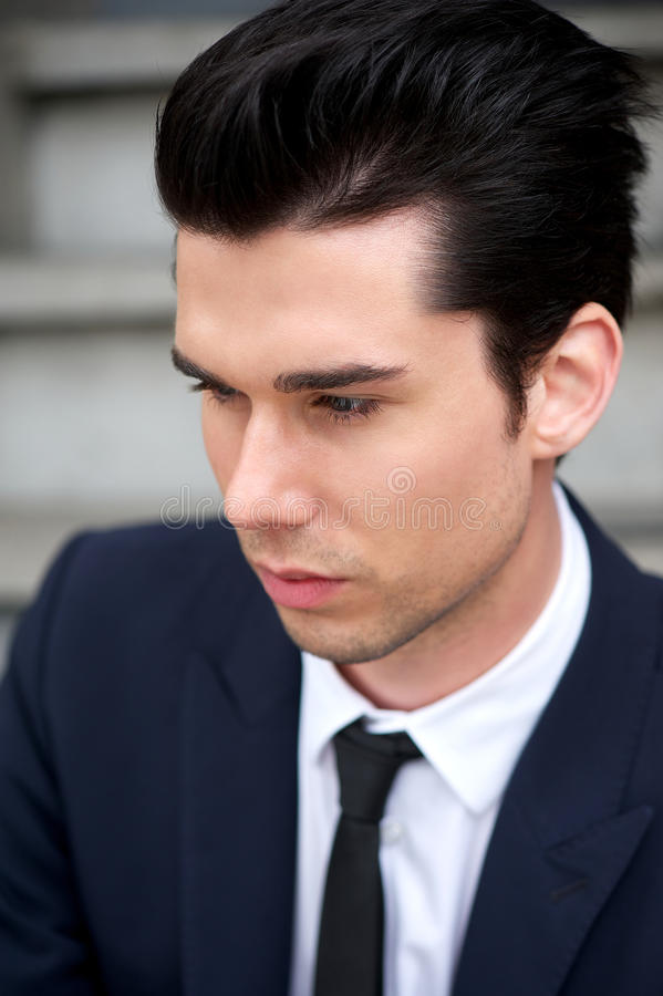 Portrait of a handsome young man in suit and tie stock image