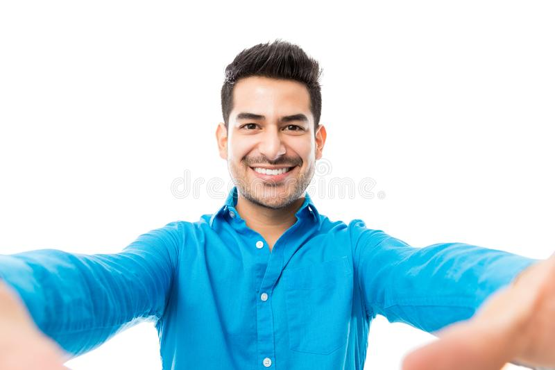 Portrait Of Handsome Young Man Taking Picture Of Himself. Over white background stock photo