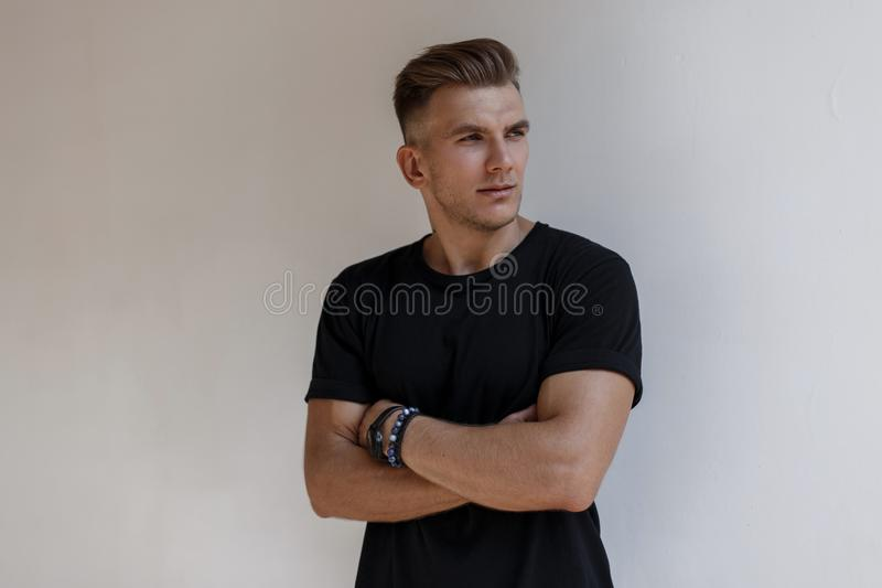 Portrait of handsome young stylish man model with hairstyle royalty free stock images